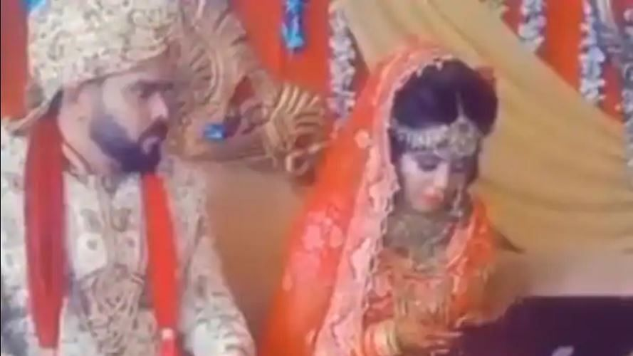 WATCH: Workaholic bride works on laptop on her wedding day