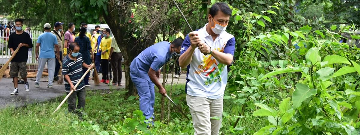 Education minister T Radheshyam carrying out a cleanliness drive on Saturday