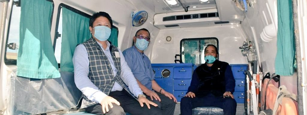 (From right) Dy CM Y Patton, health minister S Pangnyu Phom and PHED minister Jacob Zhimomi seen in an ambulance