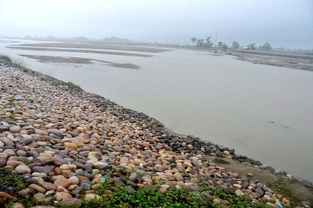 Construction work in progress on the Kumotiya river in Dhemaji district