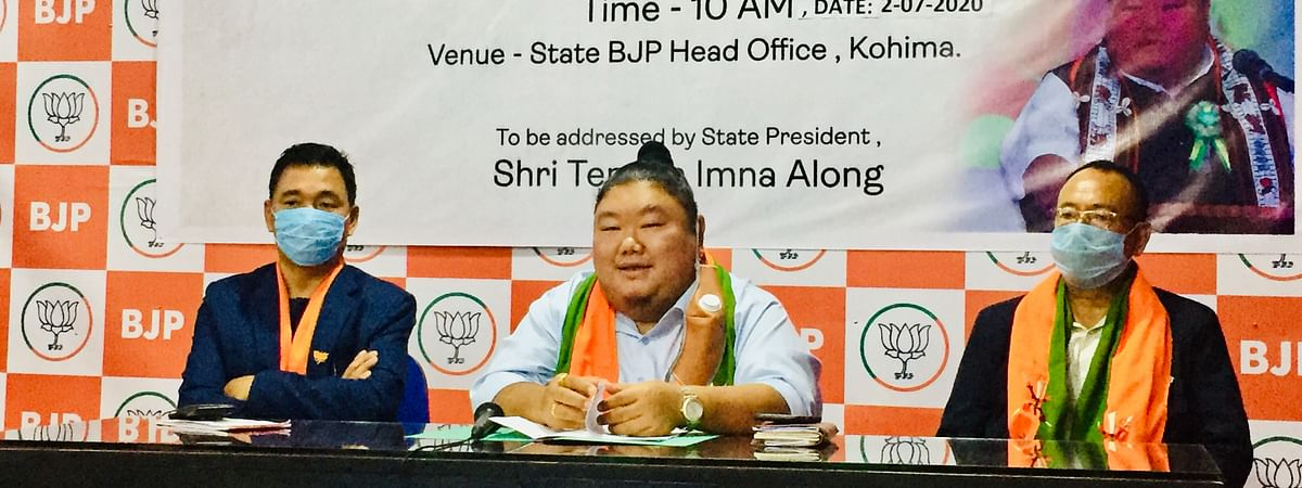 Nagaland state BJP unit president Temjen Imna Along (c) along with party officials on Thursday