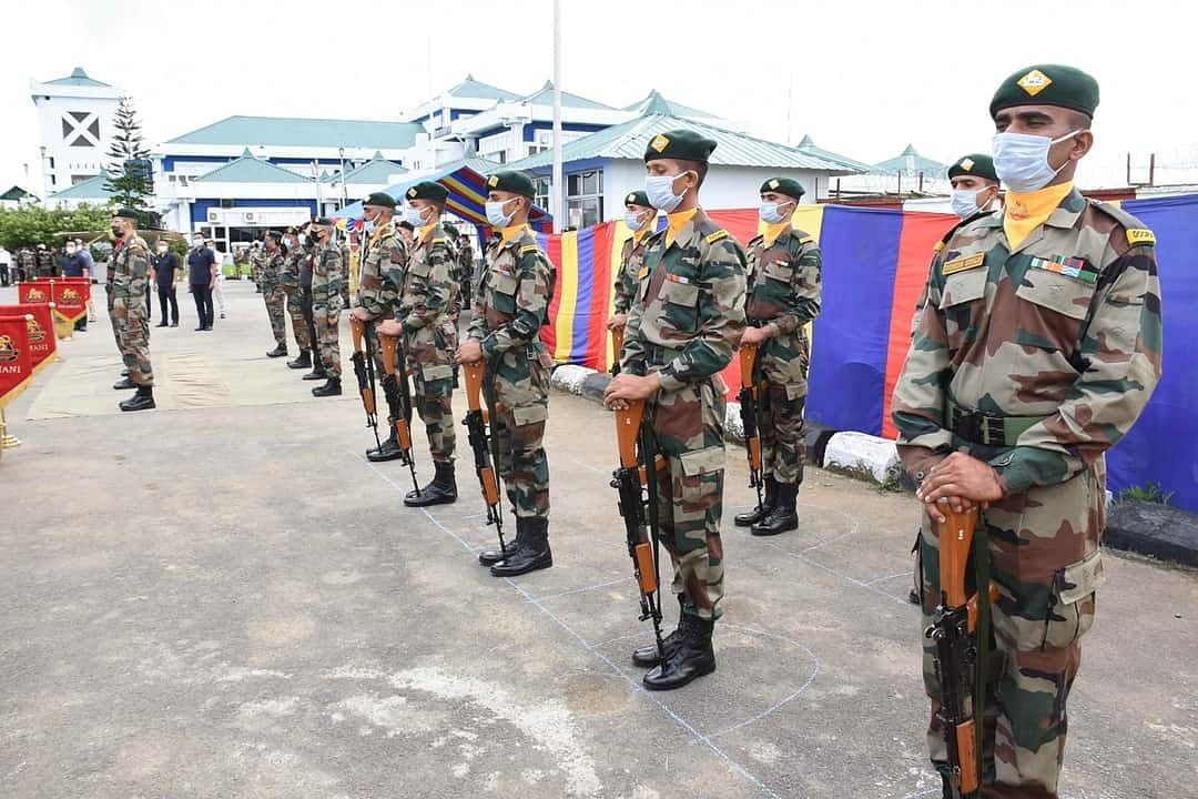 Assam Rifles personnel paying tribute to three martyrs in Imphal on Friday