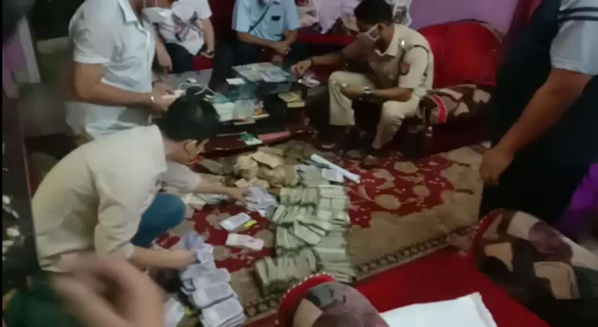 Policemen with the seized cash in Guwahati