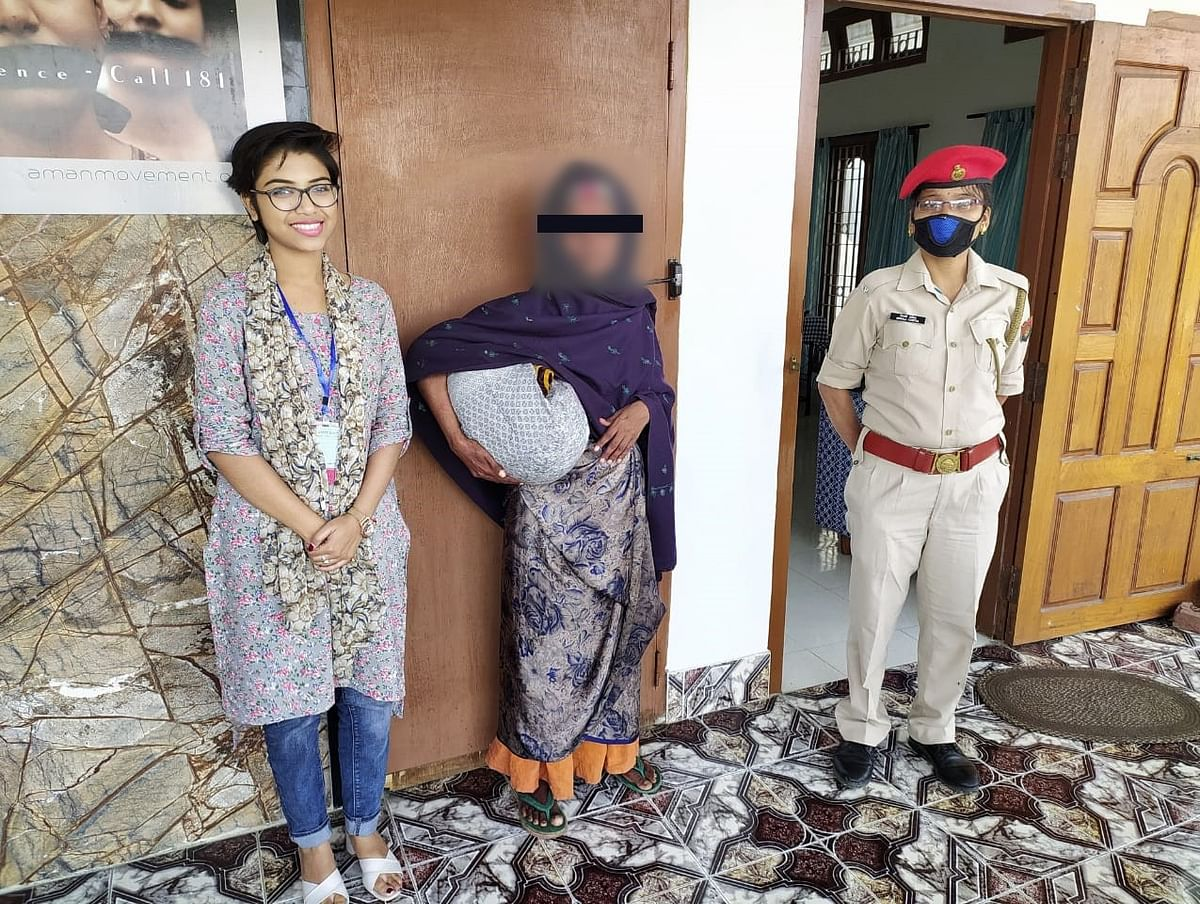 SAKHI Dibrugarh OSC coordinator Anindita Laha and a woman police constable with Anita (name changed), a victim