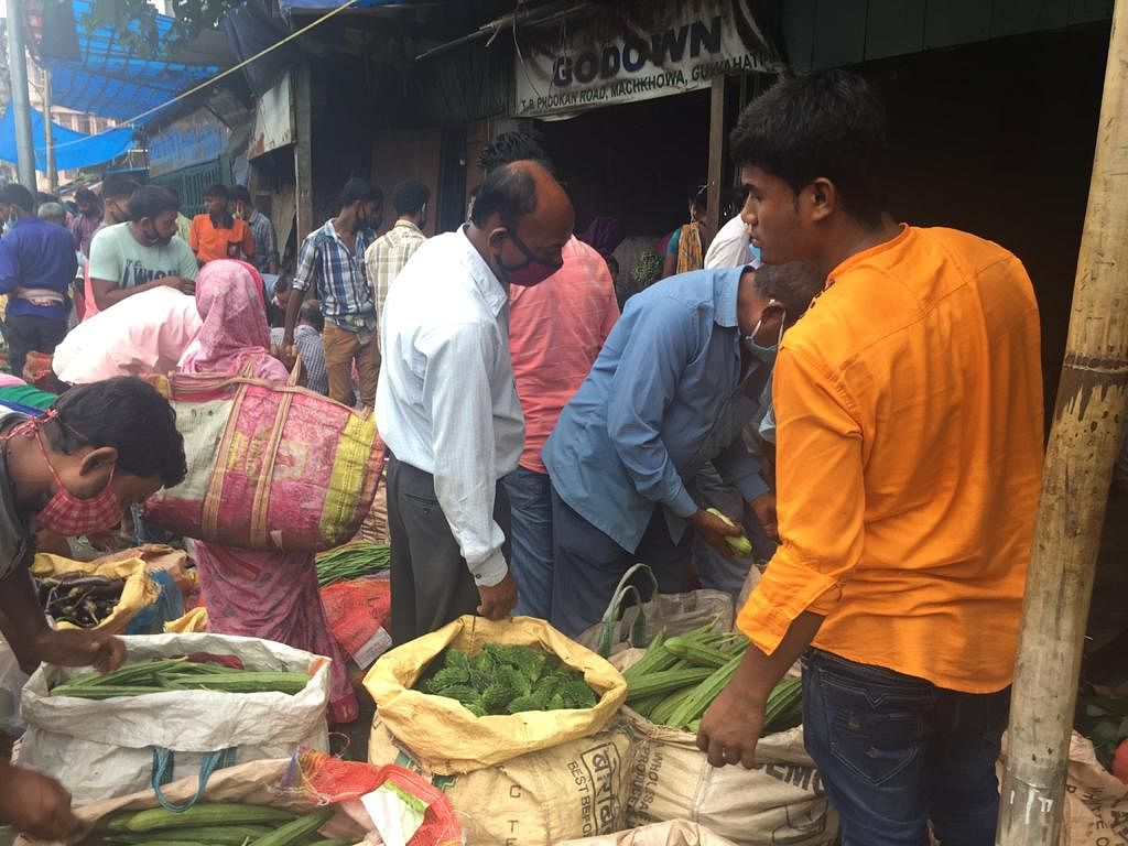 The vegetable market in Machkhowa ]was filled with buyers and sellers on all doing their business in close proximity on Wednesday morning