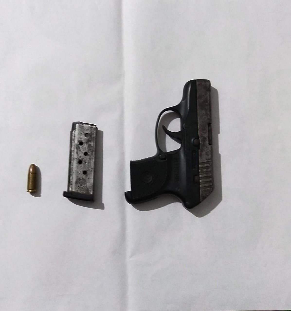 A factory-made 7.65 mm pistol with one magazine and live bullet were recovered from their possession