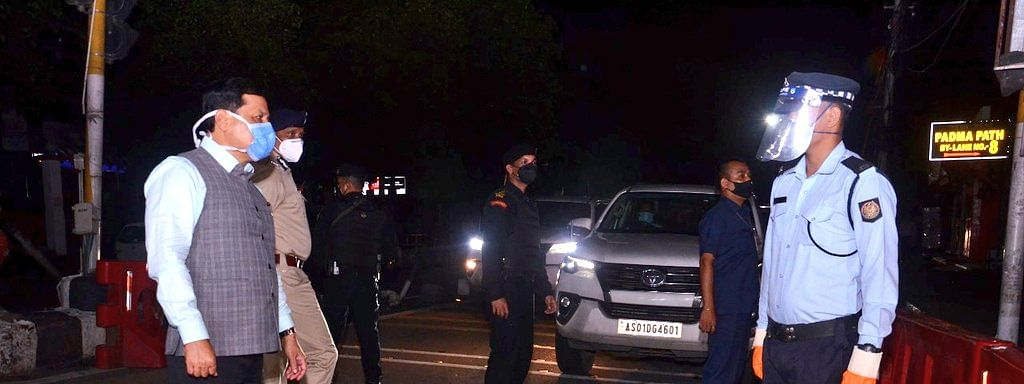 Assam CM Sarbananda Sonowal interacting with a traffic police on duty on Zoo Road in Guwahati on Wednesday night