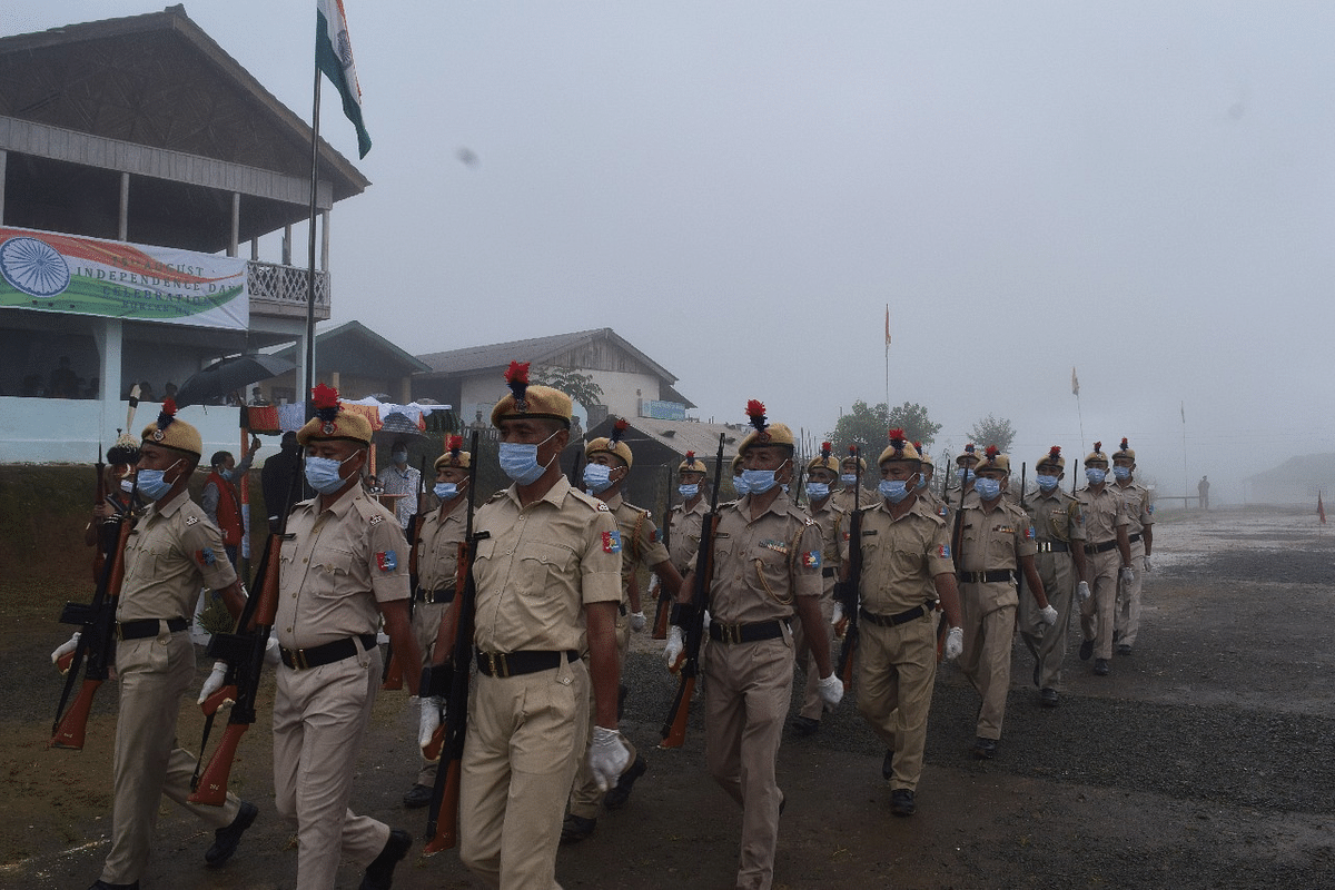 With masks on, police personnel seen marching