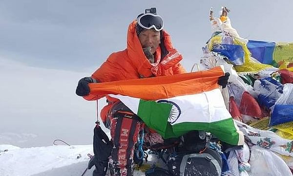 Taka Tamut after scaling Mt Everest in May 2018