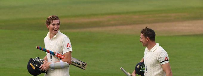Zak Crawley (L) and Jos Buttler (R) return to the pavilion unbeaten on 171 and 87, respectively, at the end of Day 1