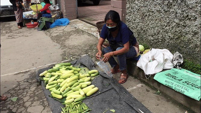 A street vendor selling cucumbers on Saturday
