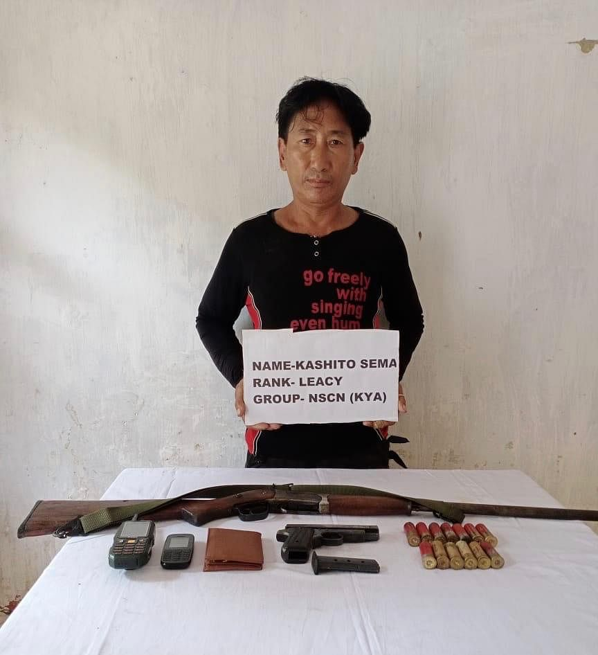 The arrested NSCN K-YA cadre along with the recovered items