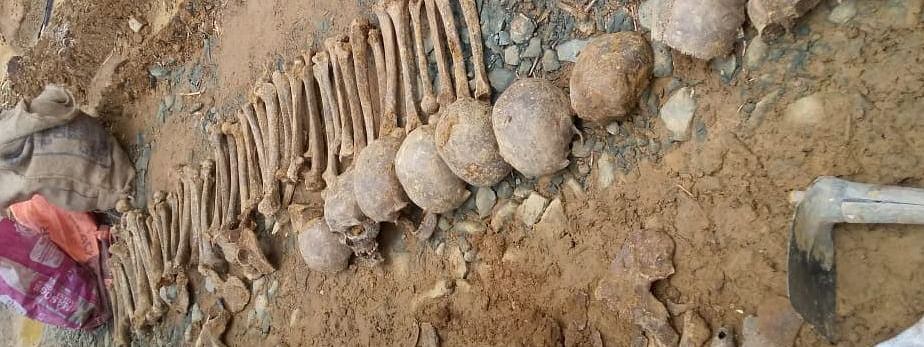 The skulls and skeletons of about 12 adults were discovered 7 ft beneath the ground