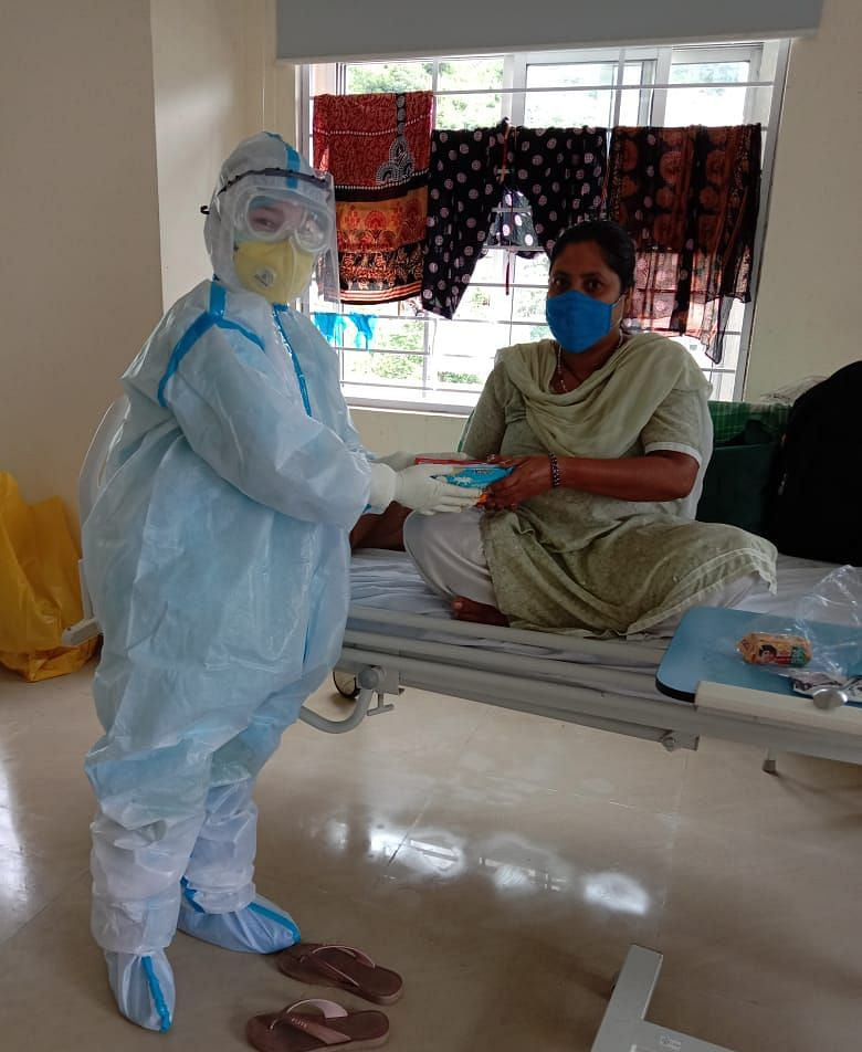 Health care workers aiding the patients in the Hospital. Not sure if the image is from the COVID wards