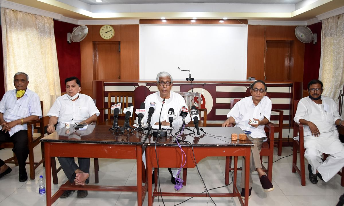 Opposition leader Manik Sarkar (middle) addressing a press conference at CPIM party headquarters on Friday