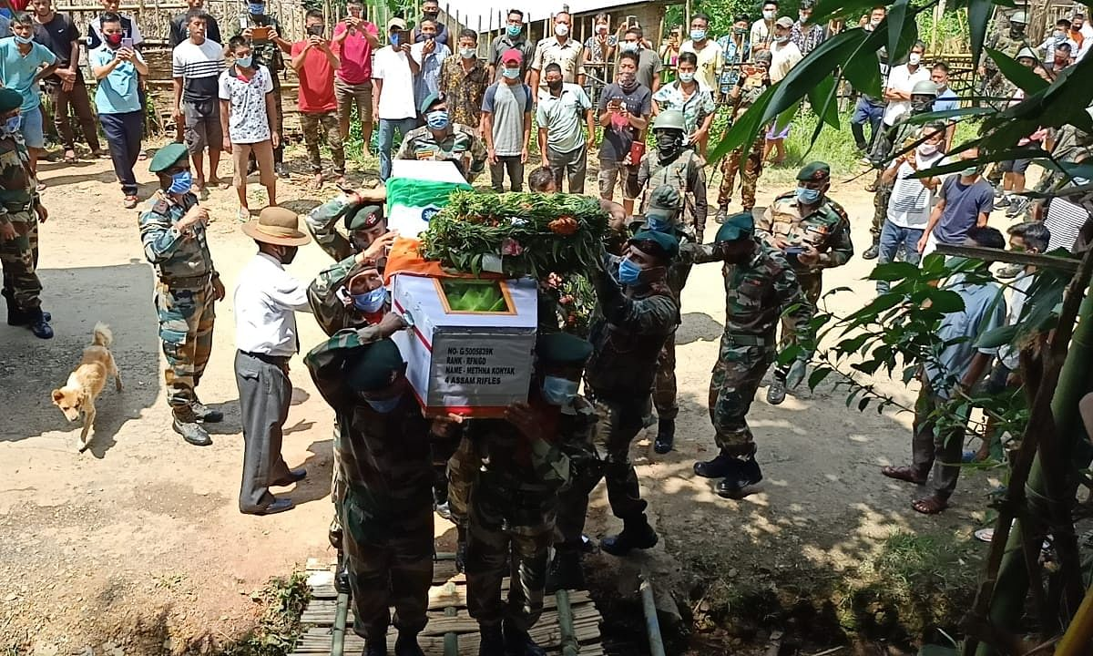 The deceased was laid to rest with full military honour in his native town in Mon district.