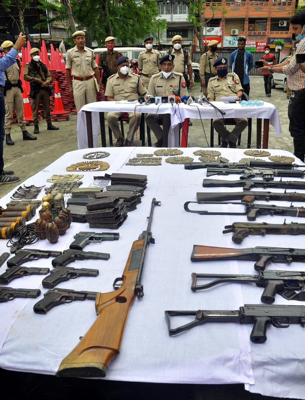 Senior Police officials display the recovered items