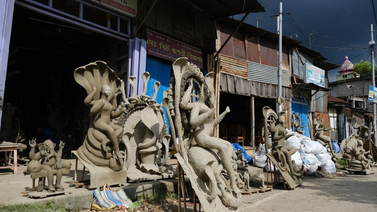 The streets are lined with Manasha Devi idos as idol makers are uncertain of the occurrence of Durga Puja this year
