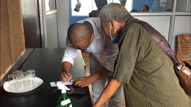 An elderly man registering himself for the free eye check up service on Tuesday