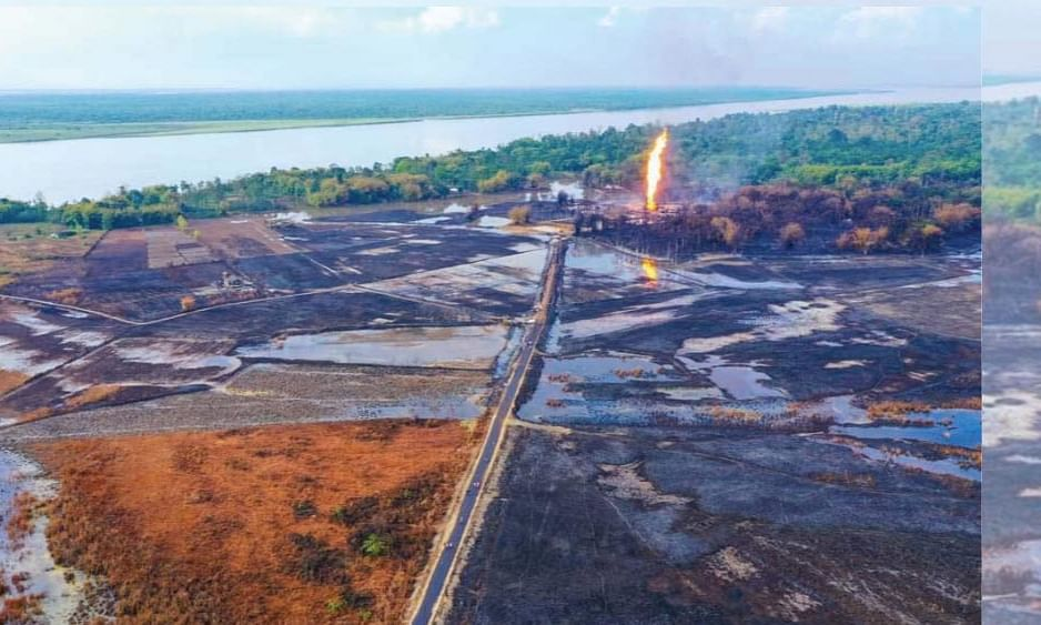 Surrounding landscape burnt from the explosion of the Baghjan oil well blowout in Assam's Tinsukia district, along with the resulting oil spill.