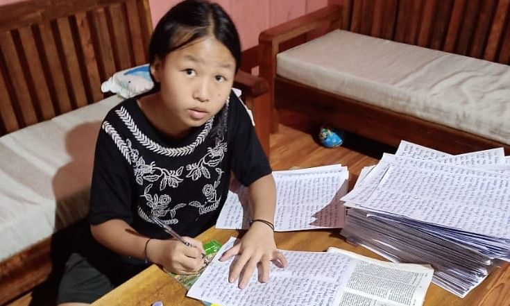 Ngahminnei Kholhou from Kangpokpi district writing the Bible passages word by word