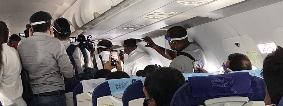 Mediapersons standing close to one another in Mumbai-Chandigarh flight on Wednesday