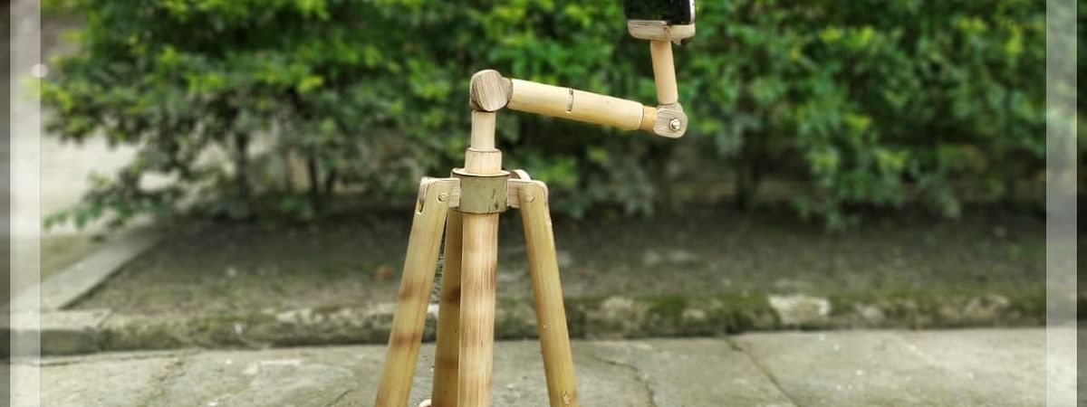 A mobile phone tripod made of bamboo