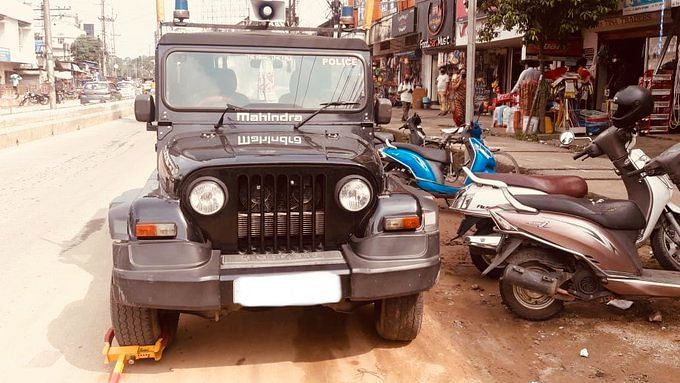 The account shared a picture of a Police jeep being clamped for violating parking rules