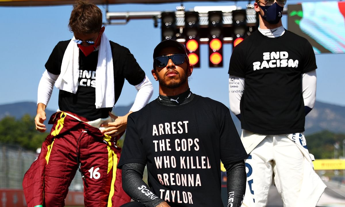 Hamilton took a knee ahead of Sunday's race, wearing a black T-Shirt with the message 'Arrest the cops who killed Breonna Taylor'