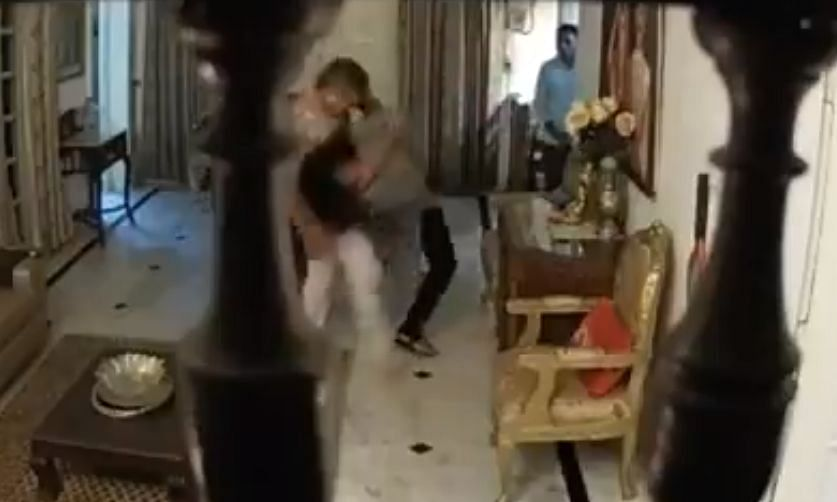 The moment when Sharma pushes his wife on the ground
