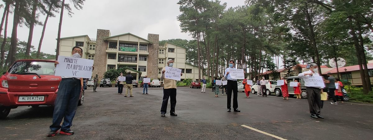 Joint Action Committee members of NEHU stage a silent protest in the campus on Tuesday