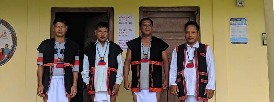 Employees at a health centre in East Siang district in Adi tribe's traditional dress.
