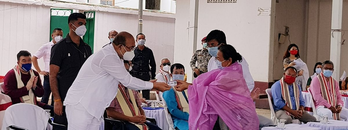 CM N Biren Singh handing over old age pension card to the beneficiary