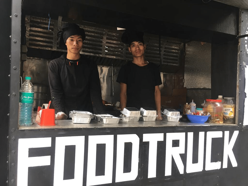 Two employees at the food truck pose for a photo on Tuesday