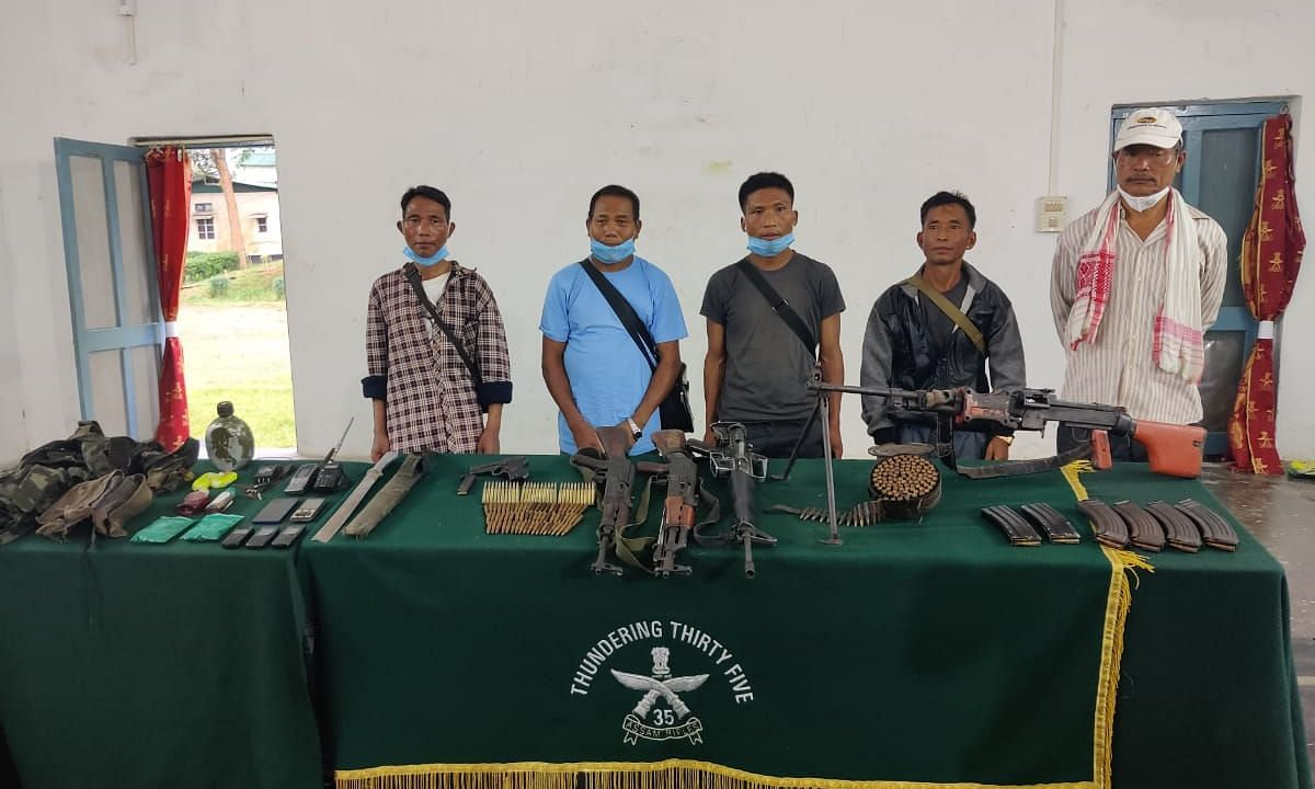 Picture of former NSCN (K) leader and his bodyguards with weapons allegedly at 35 Assam Rifles in Mon, Nagaland