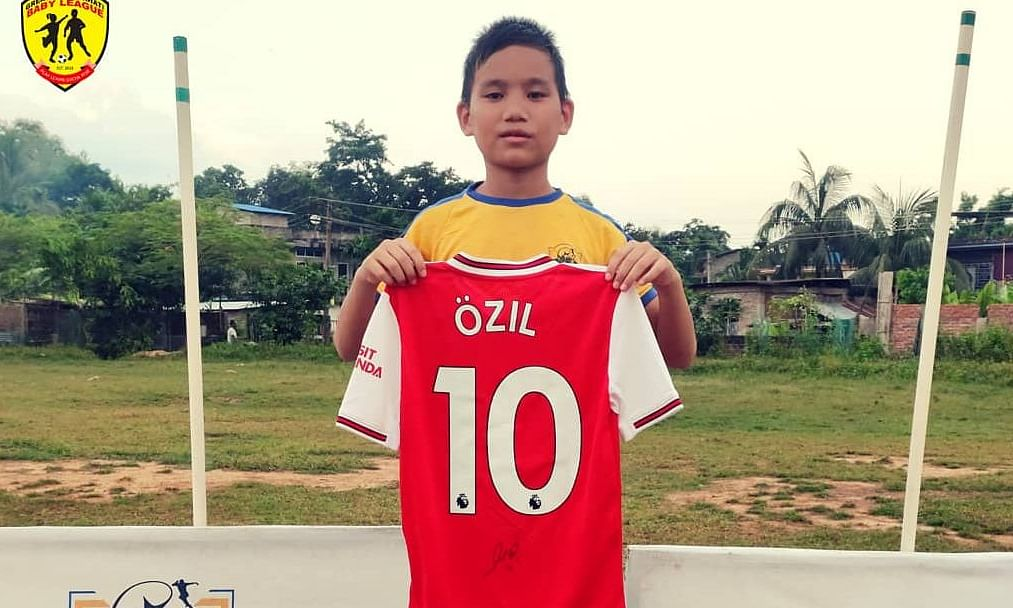 Pritam Brahma with the self-autographed Arsenal Jersey from Arsenal FC icon and German midfield maestro Mesut Ozil