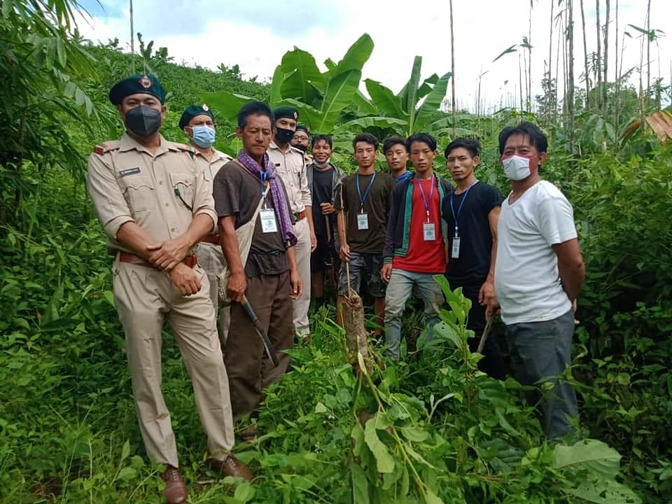Staff of Tamenglong Forest Division and Puching Village volunteers patrolling the roosting site of Amur falcons in Tamenglong district