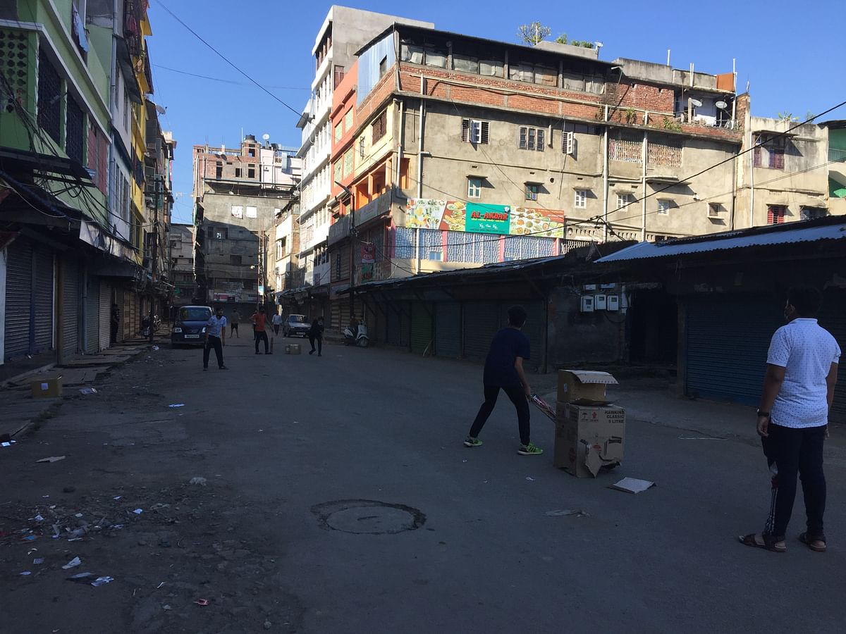 Kids playing cricket on the empty street at Thangal bazaar on Thursday