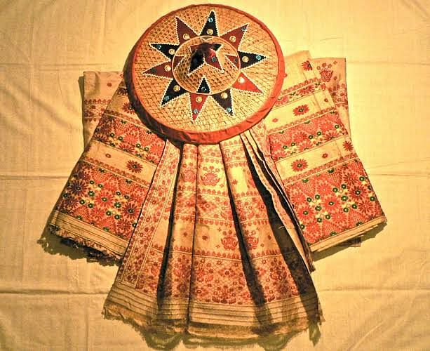 Jaapi is a conical shaped hat with a wide brim found in Assam