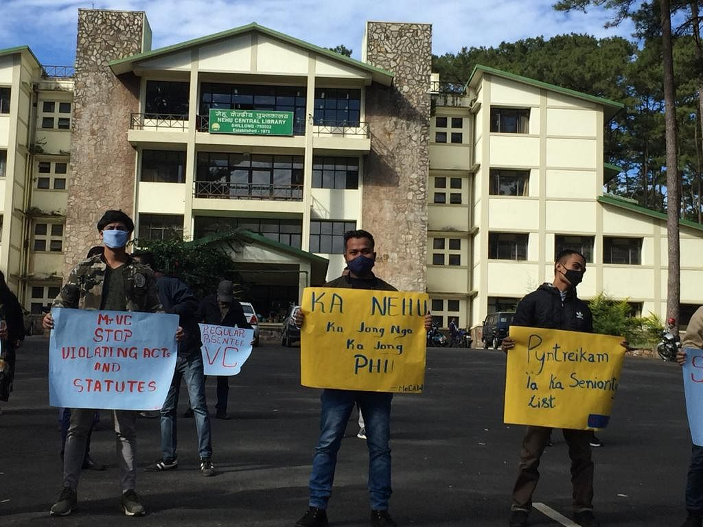 Members of MeCAW carrying placards demanding the removal of NEHU VC