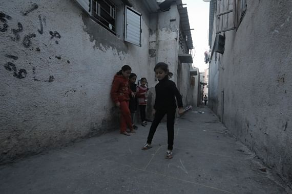 A group of girls play Al-Hjelle ( hopscotch) game behind their homes, in Gaza street.