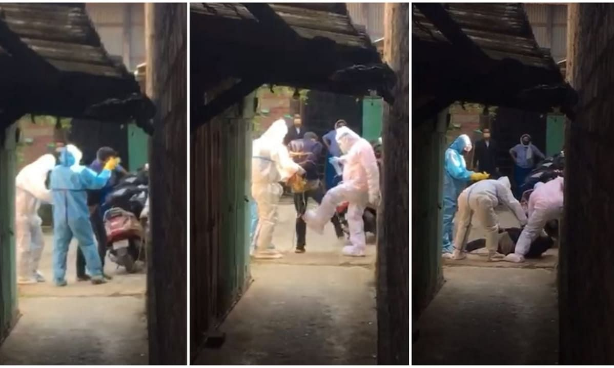 In the video, three healthcare workers can be seen struggling to bind a patient with rope