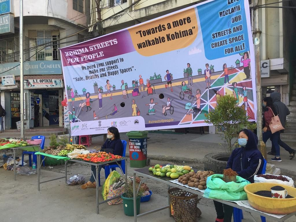 Street vendors await customers during the pop-up street space in Kohima