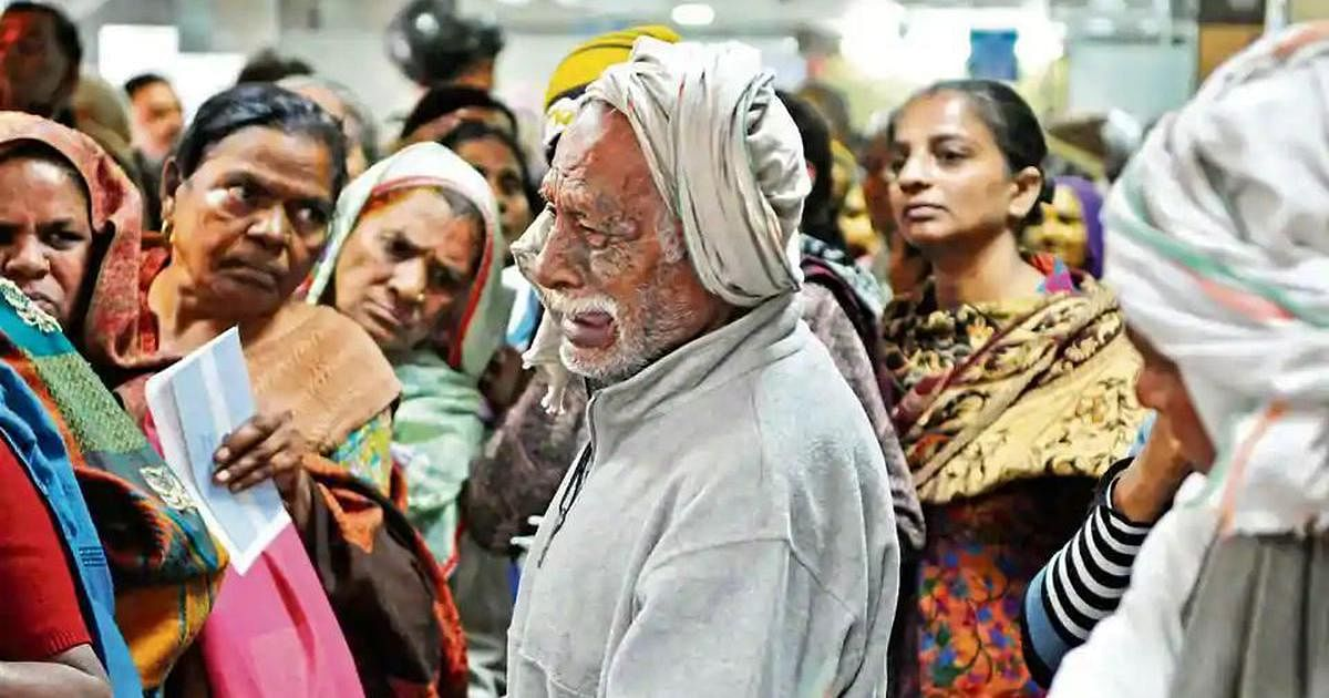 An old man struggling in a queue outside a bank.