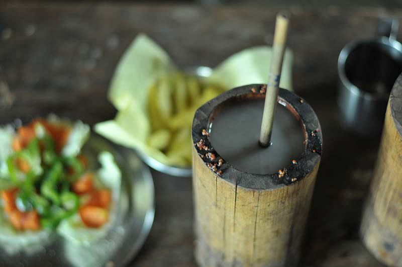 For making this beverage, the whole grain millet is cooked and then fermented