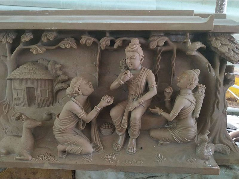 Stone tableau depicting a story of devotion