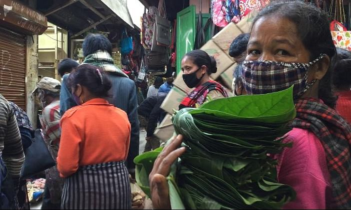 A lady making ends meet by selling betel leaf at Iewduh market