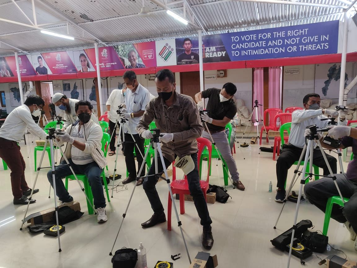 Deputed staff for videography trying hands on the equipment in Imphal on Monday