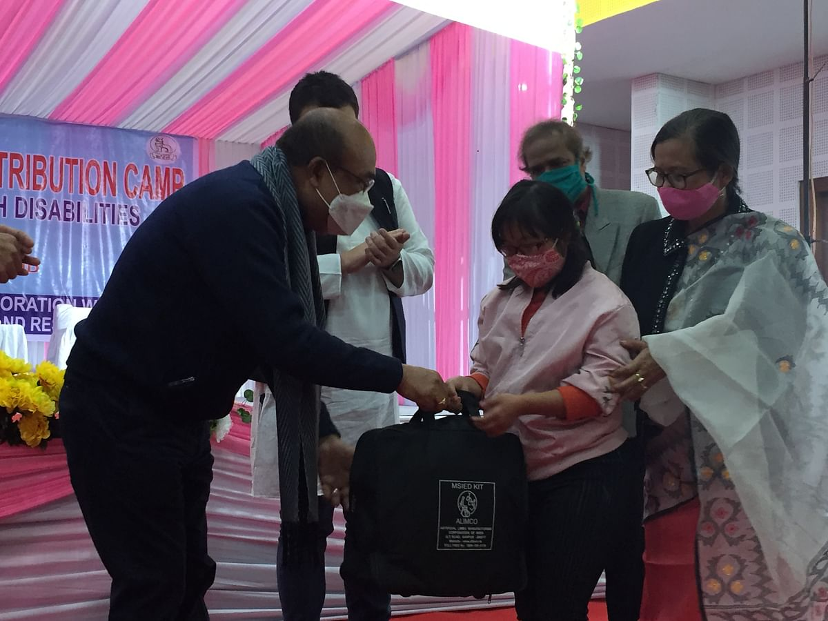 CM Biren Singh handing over the assistive devices to the beneficiary
