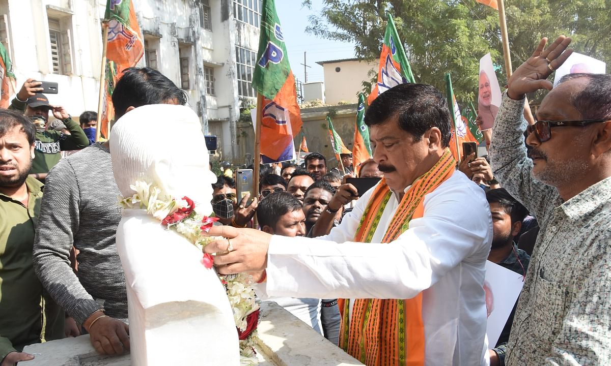 Former BJP MLA and health minister Sudip Roy Barman garlands statue of former Prime Minister Atal Bihari Vajpayee on Friday